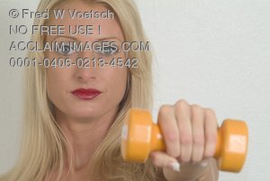 Stock Photo of a Woman Holding a Dumbell Weightin Front of Her