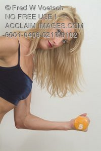 Stock Photo of a Woman Working Out With a Dumbell Weight