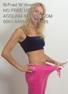 Stock Photo of a Woman Wearing Loose Pants - Weight Loss