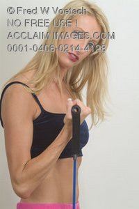 Stock Photo of a Strong Woman Exercising With Exercise Bands