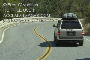 Art Stock Photo of an SUV on a Winding Highway
