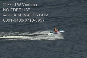 Stock Photo of a Jet Skier Racing Over Waves on Lake Kaweah