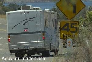 Stock Photo of an RV Passing a Traffic Sign
