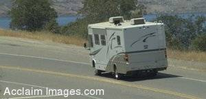 Stock Picture of an RV Driving On a Highway Beside a Lake