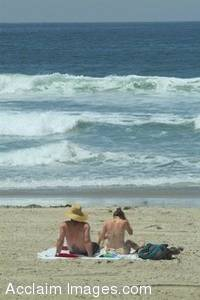 Stock Photo of a Couple Relaxing on the Beach