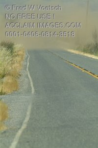 Stock Photo of a Dust Storm Across a Country Road