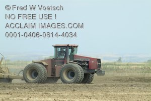 Stock Photo of a Tractor in a Field