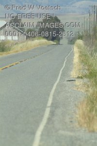 Stock Photo of a Country Road With a Barn and Telephone Poles