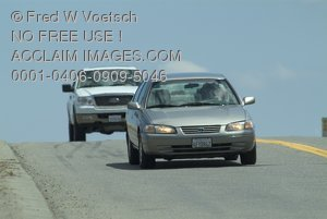 Stock Photo of Two Cars Traveling on a Road