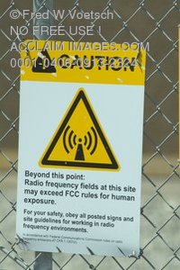 Stock Photo of a Caution Sign on a Fence