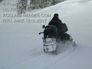 Stock Photo of a Person Riding a Snowmobile