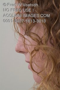 Stock Photo of a Profile of a Red Headed Woman