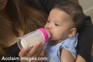 Stock Photo of a Baby Feeding From a Bottle