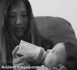 Stock Photo In Black and White of a Mother Feeding Her Child