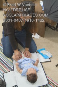 Clip Art Stock Photo of a Mother Changing Her Baby