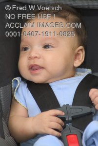 Stock Photo of a Baby Safely Buckled in a Car Seat