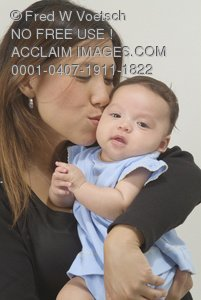 Stock Photo of a Mother Kissing Her Baby