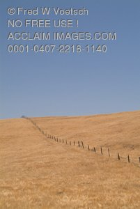 Stock Photo of a Fence on a Country Hill