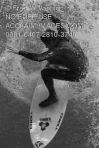 Stock Photo of a Surfer Riding a Wave