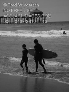 Stock Photo of Surfers on a Beach