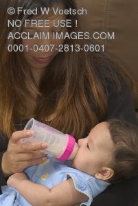 Stock Photo of a Mother Bottle Feeding Her Baby