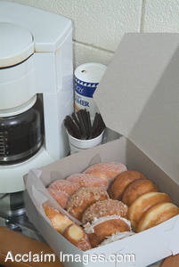 Stock Photo of a Pot of Coffee and a Dozen Donuts