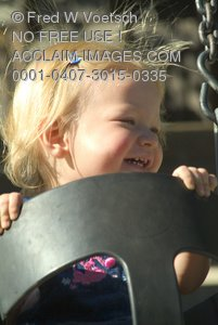 Stock Photo of a Little Girl in a Swing