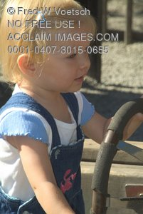 Stock Photo of a Little Girl Playing With a Steering Wheel at a Playground