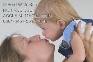 Stock Photo of a Mother Kissing Her Baby Girl