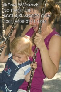 Stock Photo of a Mother and Daughter on a Tire Swing