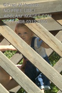 Stock Photo of a Girl Playing On Wooden Beams