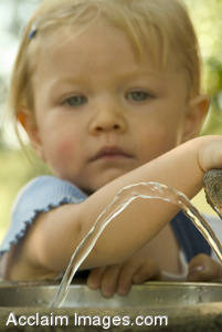 Stock Photo of a Small Girl at a Drinking Fountain