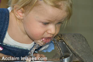 Stock Photo of a Little Girl Drinking From a Water Fountain