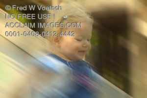 Stock Photo of a Girl Going Down a Slide