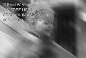 Black and White Stock Photo of a Girl Going Down a Slide