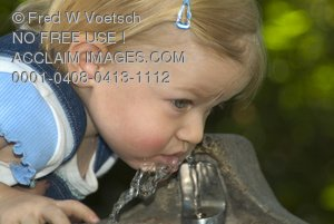 Stock Photo of a Girl Drinking From a Water Fountain