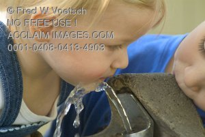 Stock Photo of Two Kids at a Drinking Fountain