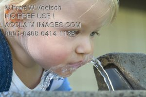 Stock Photo of a Girl Drinking From a Drinking Fountain