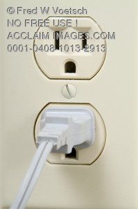 Stock Photo of a Plug in an Electrical Socket