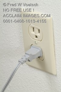 Stock Photo of a Plug In an Electrical Outlet
