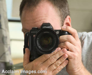 Stock Photo of a Photographer Taking a Photo