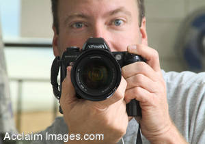 Stock Photo of a Photographer Looking Directly into our Camera