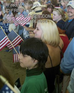 Stock Photo of People in a Crowd Waving Flags