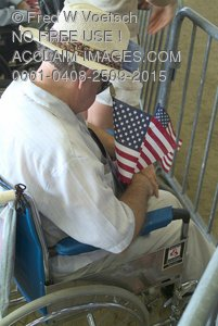 Stock Photo of an Elderly Man In Wheelchair Holding a Flag