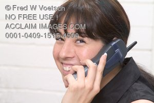 Stock Photo of a Woman Smiling As She Talks On a Phone