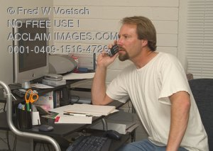 Clip Art Stock Photo of a Man Talking On a Phone At a Computer Desk