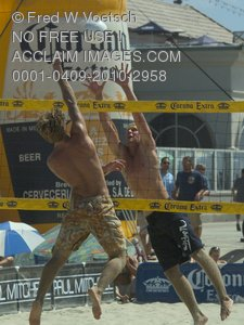 Stock Photo of Two Pro Beach Volleyball Players