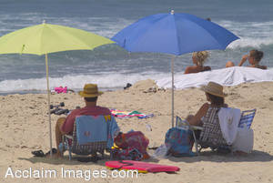 Stock Photo of a Couple Lounging On a Beach