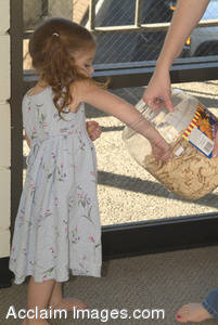 Stock Photo of a Little Girl Reaching with Her Hand in a Cookie Jar