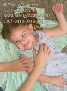 Clip Art Stock Photo of a Little Girl Being Tickled By Her Mom